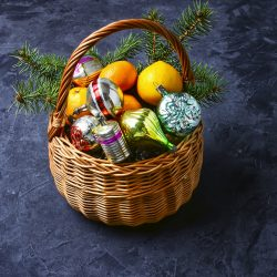 Wicker basket with vintage Christmas toys and gifts